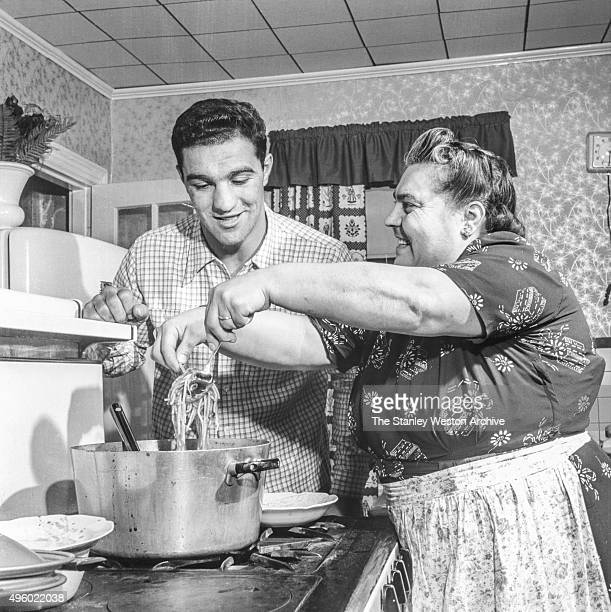 Rocky Marciano with his mother in the kitchen of the house he grew up on July 1 1953 in Brockton Massachusetts