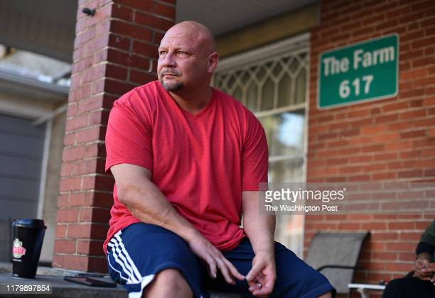Rocky Meadows, founder of Lifehouse recovery and treatment center, and former addict, sits on the front porch of The Farm recovery house on October...