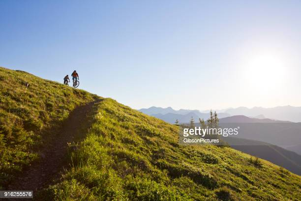 rocky mountain bike adventure - cross country cycling stock photos and pictures