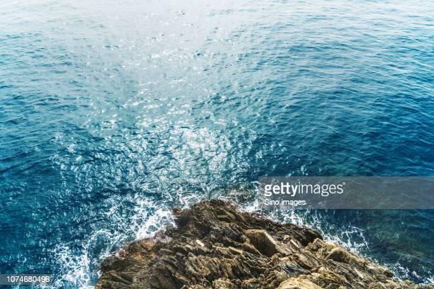 rocky mountain in sea, italy - image foto e immagini stock