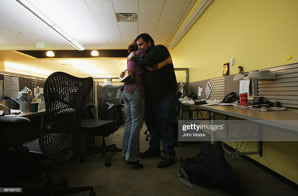 Rocky Mountain News photographers Barry Gutierrez and Ellen Jaskol embrace during their final minutes in the photo department on February 27, 2009 in Denver, Colorado. Friday's edition was the last for the nearly 150-year-old daily, Colorado's oldest newspaper. The owner E.W. Scripps Co. announced Thursday that the paper was closing down after efforts to sell the money-losing newspaper failed. About 200 Rocky staffers lost their jobs in the closing.