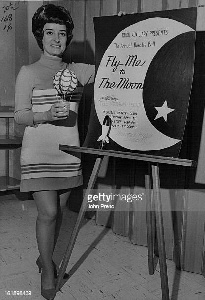APR 7 1970 APR 9 1970 Rocky Mountain Osteopathic Hospital Auxiliary To Launch Moon Flight Party Mrs Larry L Odekirk displays poster for Fly Me to the...