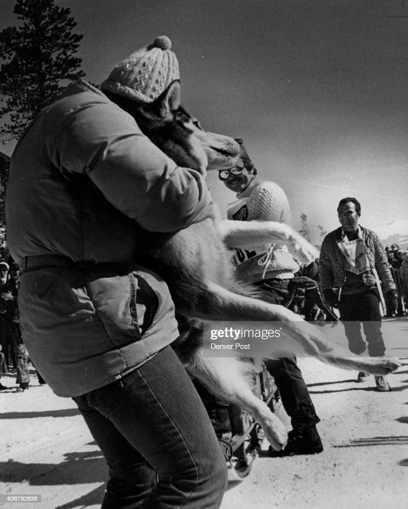 Rocky Mountain Sled Dog Club Gail Lifts Her 65-pound Dog