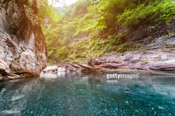 rocky mountain valley and beautiful green stream - hualien county stock pictures, royalty-free photos & images
