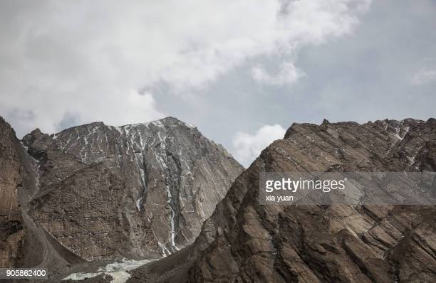 Rocky Mountains Against Cloudy Sky On Pamir Plateau,Xinjiang,China