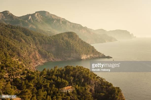 Rocky mountains along coastline in fog, Serra de Tramuntana, Mallorca, Balearic Islands, Spain