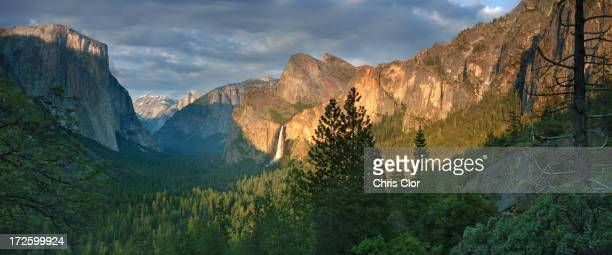 Rocky mountains overlooking rural valley, Yosemite, California, United States