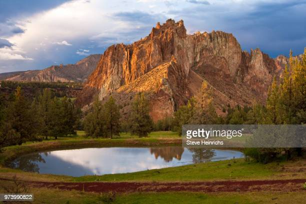 Rocky mountains with lake in foreground of Smith Rock State Park, Deschutes county, Oregon, USA