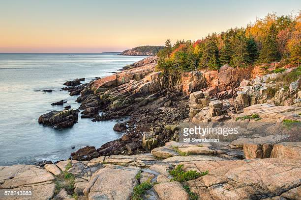 rocky new england shoreline in autumn - bar harbor stock photos and pictures