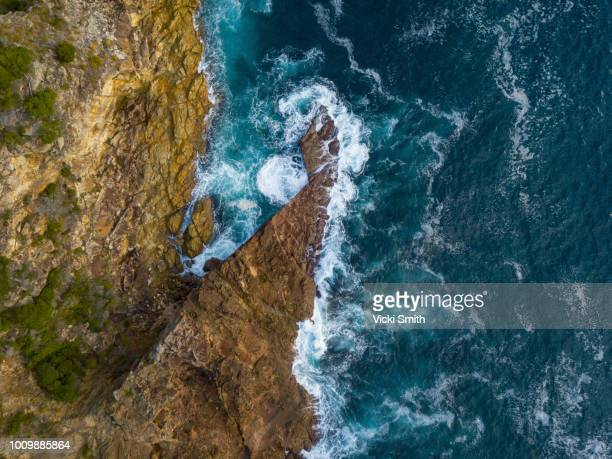 rocky outcrop into ocean - coastline stock pictures, royalty-free photos & images