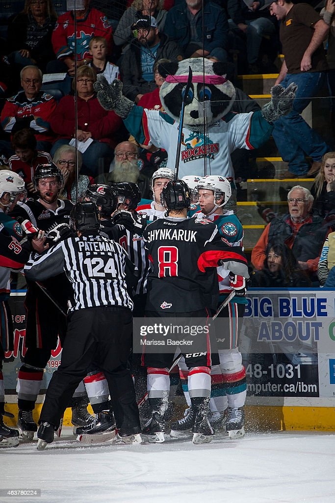 Rocky Racoon, the mascot of the Kelowna Rockets mocks players of the Moose Jaw Warriors after the whistle on February 14, 2015 at Prospera Place in Kelowna, British Columbia, Canada.