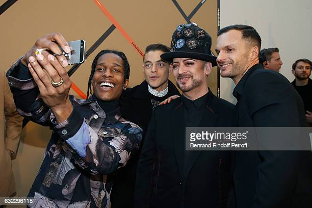 ASAP Rocky Rami Malek Boy George and Stylist Kris Van Assche pose backstage after the Dior Homme Menswear Fall/Winter 20172018 show as part of Paris...