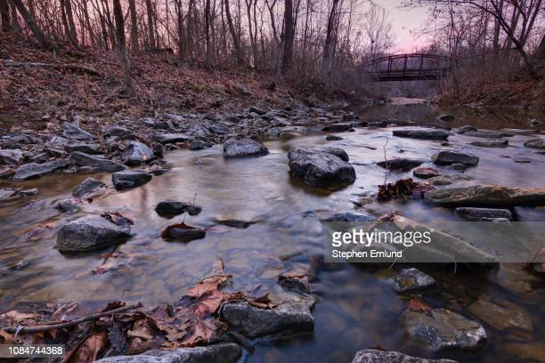 rocky river bed with bridge - columbia missouri stock pictures, royalty-free photos & images