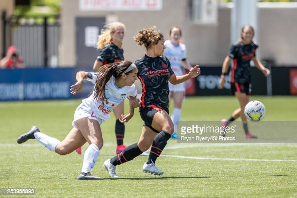 Rocky Rodriguez of Portland Thorns FC plays for the ball against Julia Bingham of Chicago Red Stars during a game between Chicago Red Stars and...