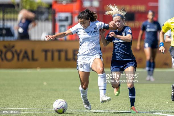 Rocky Rodriguez of Portland Thorns FC plays for the ball against Denise O'Sullivan of North Carolina Courage during a game between Portland Thorns FC...
