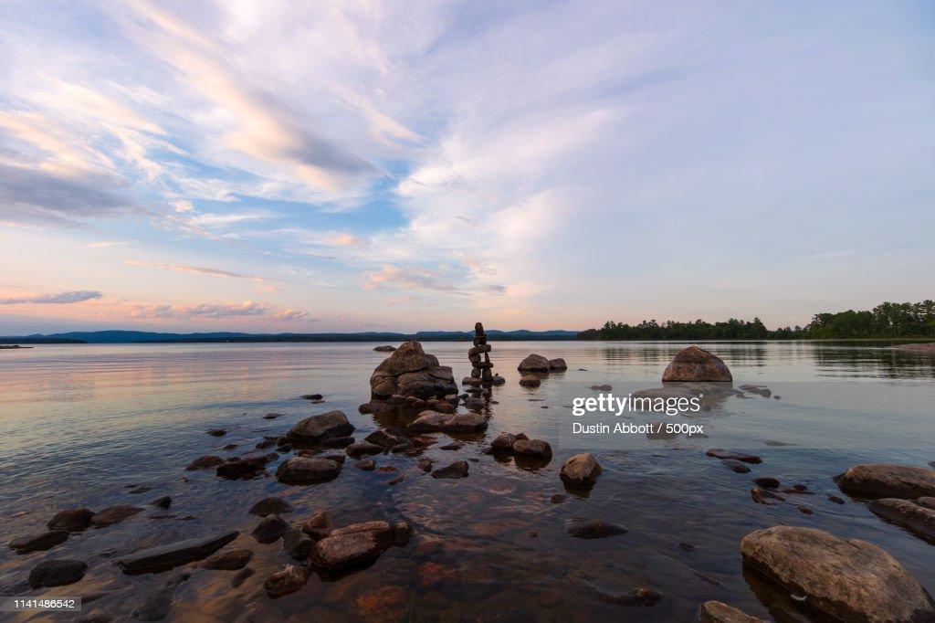 Rocky shore against dramatic sky : Stock Photo