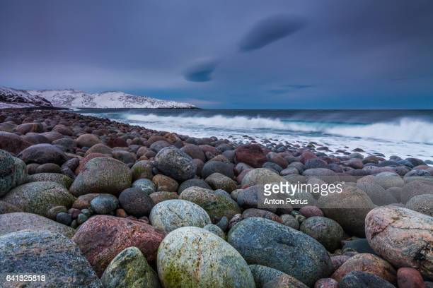 rocky shore of the barents sea during a storm - anton petrus stock pictures, royalty-free photos & images