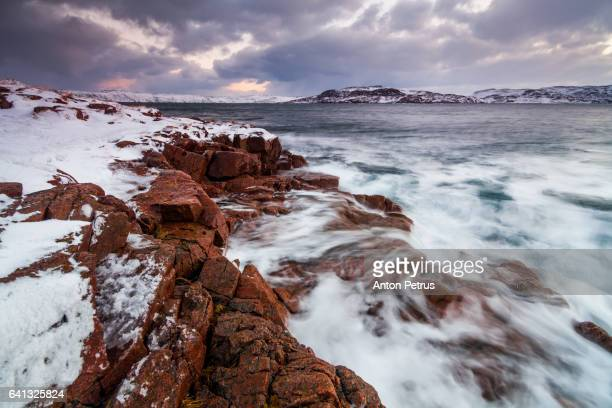 Rocky shore of the Barents Sea during a storm