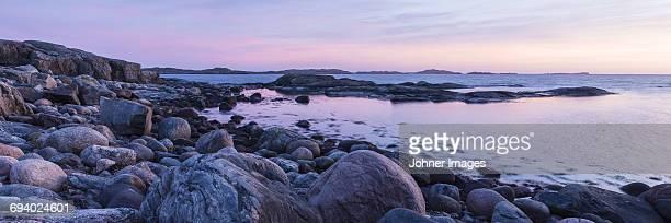 Rocky shoreline at sunset