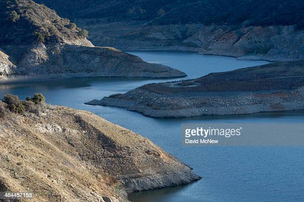 Rocky shores are exposed by the low waters of San Gabriel Reservoir on the San Gabriel River in the Angeles National Forest on January 22, 2014 in...