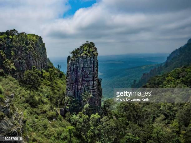 a rocky spire overlooks a valley below. - mpumalanga province stock pictures, royalty-free photos & images