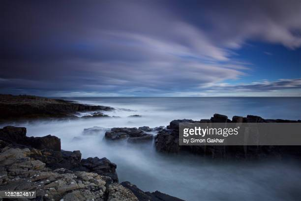rocky sunrise seascape photograph with water motion - seascape stock pictures, royalty-free photos & images