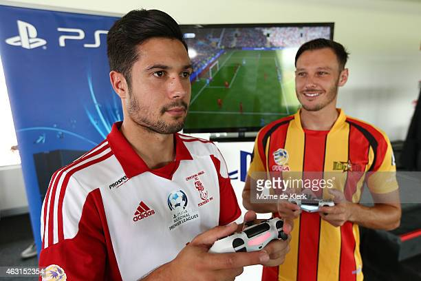 Rocky Visconte of the Croydon Kings and Fabian Barbiero of the Metro Stars try out Playstation 4 games during the PlayStation 4 National Premier...