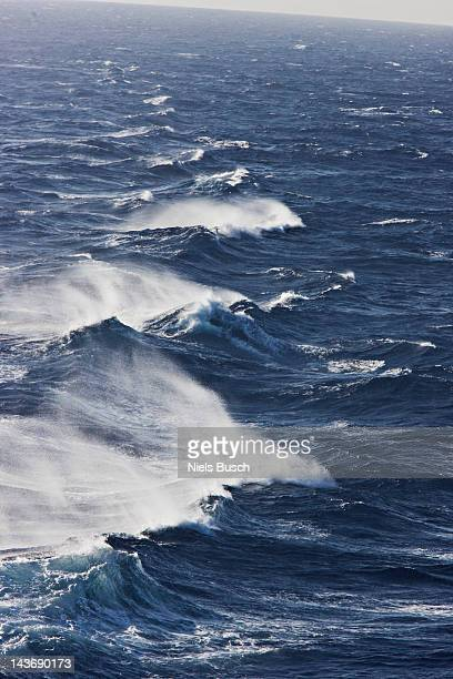 rocky waves in ocean - tide stock pictures, royalty-free photos & images
