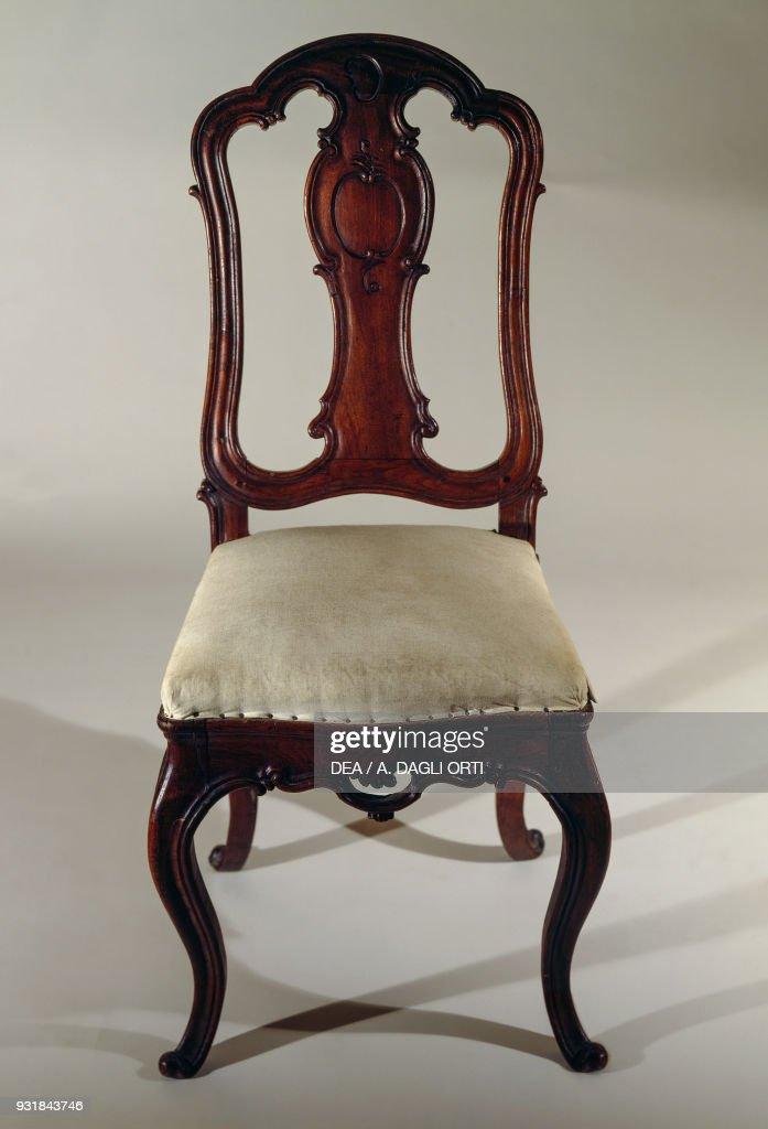 Rococo-style carved chair with upholstered seat : News Photo
