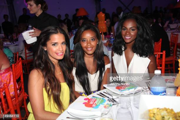 Rocsi Diaz Angela Simmons and Tika Sumpter attend the 13th Annual Russel Simmons Rush philanthropic ART FOR LIFE on July 28 2012 in East Hampton New...