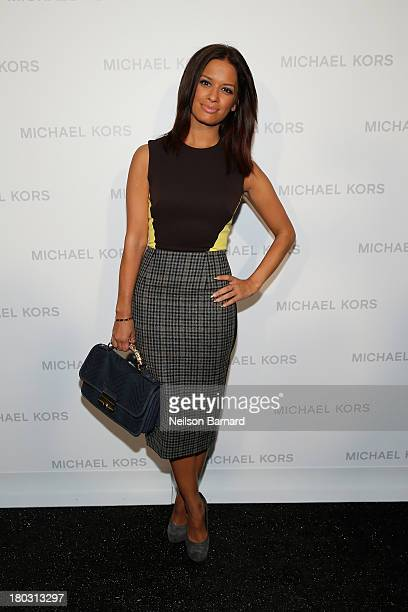 Rocsi Diaz poses backstage at the Michael Kors fashion show during MercedesBenz Fashion Week Spring 2014 at The Theatre at Lincoln Center on...