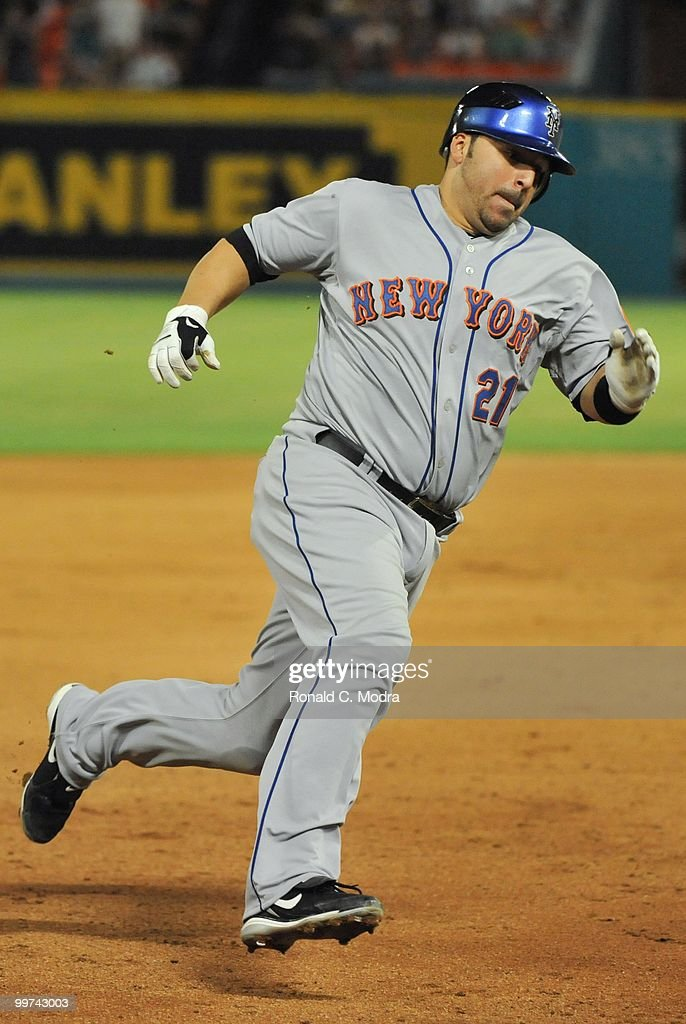 Rod Barajas #21 of the New York Mets runs to third base during a MLB game against the Florida Marlins in Sun Life Stadium on May 14, 2010 in Miami, Florida.