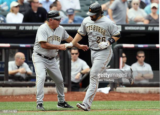 Rod Barajas of the Pittsburgh Pirates celebrates a home run with third base coach Nick Leyva against the New York Mets at Citi Field on September 27...