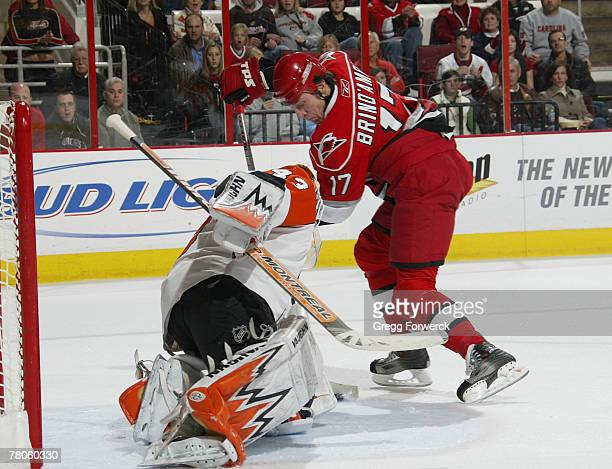 Rod Brind Amour of the Carolina Hurricanes scores a power play goal in the first period against Martin Biron of the Philadelphia Flyers on November...