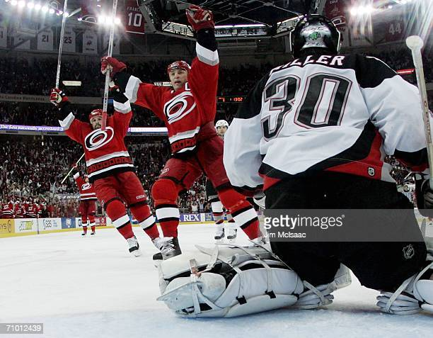 Rod Brind'Amour and Cory Stillman of the Carolina Hurricanes celebrate the team's fourth goal against Ryan Miller of the Buffalo Sabres in game two...