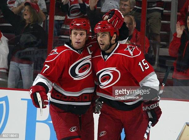 Rod Brind'Amour and Tuomo Ruutu of the Carolina Hurricanes celebrate Ruutu's first period goal against the Florida Panthers during their NHL game on...