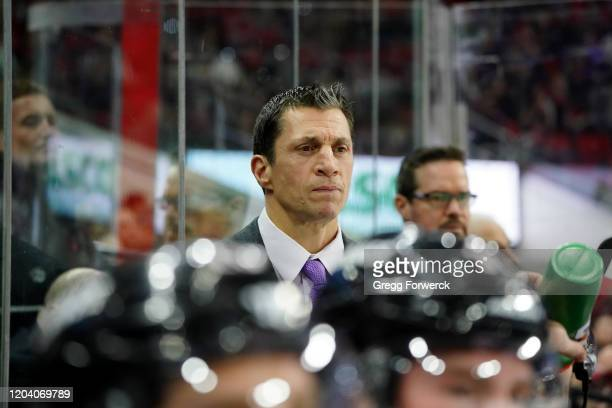Rod Brind'Amour, head coach of the Carolina Hurricanes, watches action on the ice from the bench during an NHL game against the Colorado Avalanche on...
