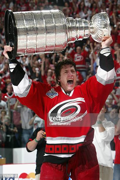Rod Brind'Amour of the Carolina Hurricanes celebrates with the Stanley Cup after defeating the Edmonton Oilers in game seven of the 2006 NHL Stanley...
