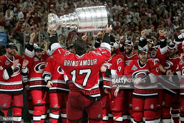 Rod Brind'Amour of the Carolina Hurricanes lifts the Stanley Cup after defeating the Edmonton Oilers in game seven of the 2006 NHL Stanley Cup Finals...