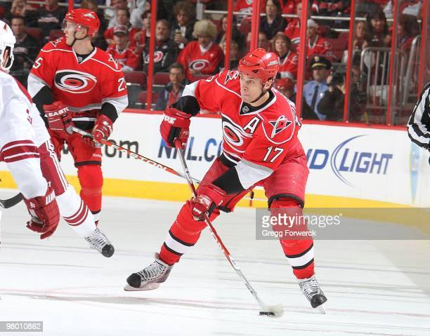 Rod Brind'Amour of the Carolina Hurricanes looks to pass the puck during a NHL game against the Phoenix Coyotes on March 13, 2010 at RBC Center in...