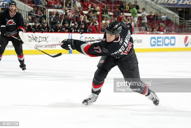 Rod Brind'Amour of the Carolina Hurricanes shoots the puck and scores on a one timer during a NHL game against the Florida Panthers on October 9,...