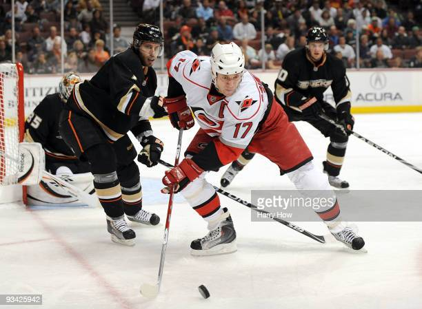 Rod Brind'Amour of the Carolina Hurricanes takes a pass in front of Steve Eminger and Corey Perry of the Anaheim Ducks during the second period at...