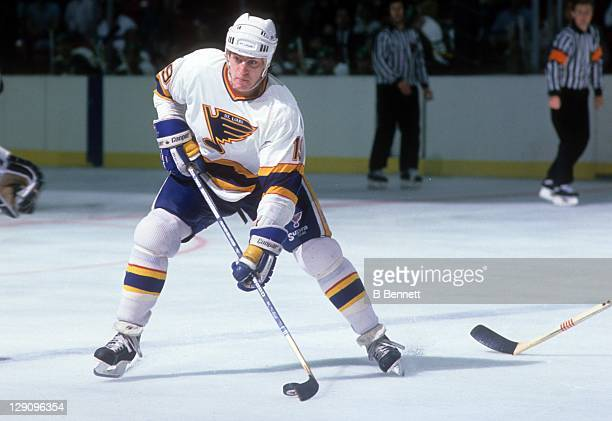 Rod Brind'Amour of the St. Louis Blues skates with the puck during an NHL game against the Minnesota North Stars on November 21, 1990 at the St....