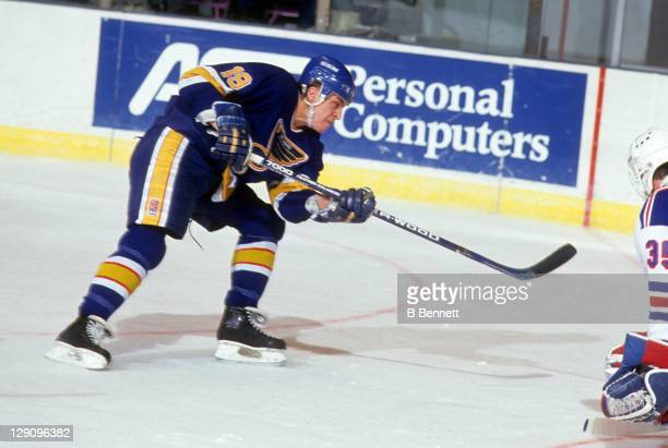 Rod Brind'Amour of the St. Louis Blues takes the shot during an NHL game against the New York Rangers on January 9, 1991 at the Madison Square Garden...