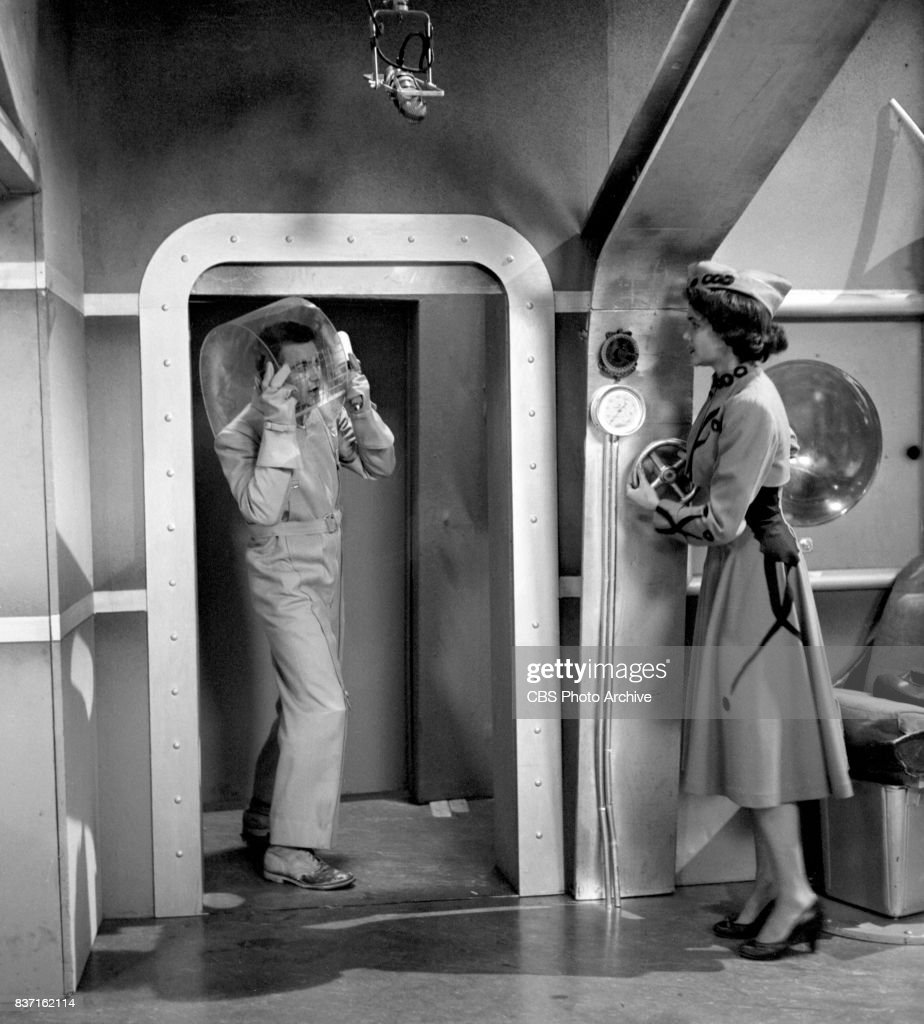 'Rod Brown of the Rocket Rangers' the CBS television science fiction series, broadcast live. Pictured is unidentified actor in entryway and actress Shirley Standlee. Premiere episode titled: Operation Decoy. New York, NY.