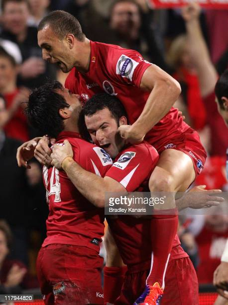 Rod Davies of the Reds celebrates a try with team mates during the Super Rugby Semi Final match between the Reds and the Blues at Suncorp Stadium on...