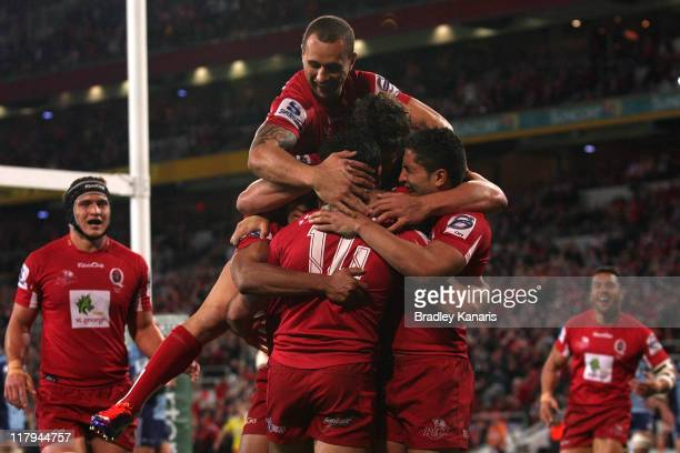 Rod Davies of the Reds celebrates with team mates after scoring a try during the Super Rugby Semi Final match between the Reds and the Blues at...