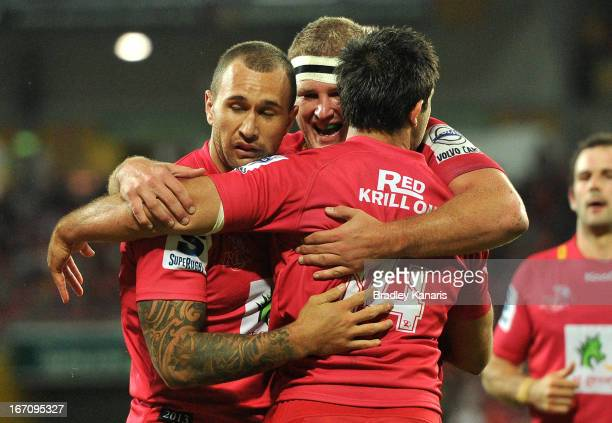 Rod Davies of the Reds celebrates with team mates after scoring a try during the round 10 Super Rugby match between the Reds and the Brumbies at...