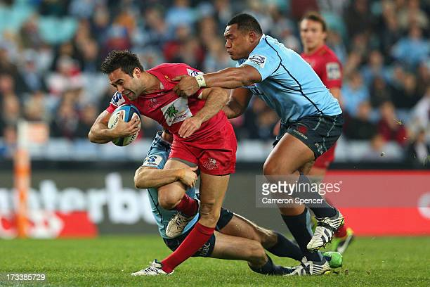 Rod Davies of the Reds injures his knee in a tackle during the round 20 Super Rugby match between the Waratahs and the Reds at ANZ Stadium on July 13...