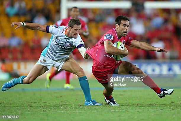 Rod Davies of the Reds is tackled by Joohan Goosen of the Cheetahs during the round four Super Rugby match between Queensland Reds and the Cheetahs...